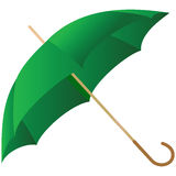 The green umbrella represented on a white Stock Photography