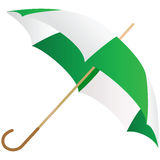 The green umbrella represented on a white. Background Stock Photo