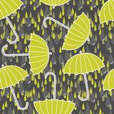 Green umbrellas in rain on dark Stock Images