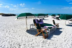 Green umbrellas on white sand in The Don Cesar Hotel beach area. St. Pete Beach, Florida. January 25, 2019. Green umbrellas on white sand in The Don Cesar Hotel royalty free stock photos