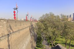 Green under the walls of xian ancient city, adobe rgb. Xian ancient city, shaanxi province, china. xian wall is chinese largest existing and most preserved royalty free stock photos