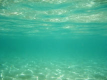 Green underwater. Background with sunrays in the sea underwater royalty free stock photos