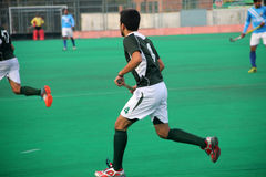 Green Uniform Hockey Player. SIALKOT, PAKISTAN - DECEMBER 2014: All Pakistan Annual Field Hockey Tournament Between PIA and PAF Teams at Sialkot International Royalty Free Stock Photo