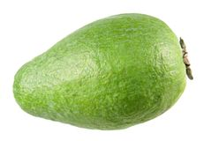 Green unpeeled feijoa fruit isolated on white royalty free stock image