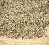 Green unroasted coffee beans on mat Stock Photos