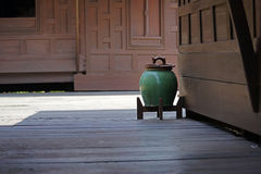 Green Urn. A beautiful green urn set in a backdrop of teak buildings Stock Image