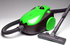 Green vacuum cleaner Stock Image