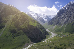 Green valley of the Caucasus Mountains in summer. Sunrise Stock Images