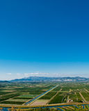 Green valley with clear blue sky. Green Neretva valley with many crop fields and blue sky on upper side Stock Photos