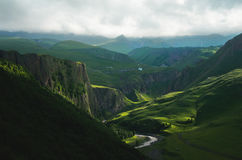 Green valley at the foot of Elbrus with a mountain river at the bottom of the gorge Royalty Free Stock Photo