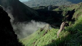 Green valley formed from a volcano with smoke earth from hydrogen sulphide
