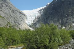 Green valley and Glacier Briksdal. Olden, Norway. 2012-06-11 stock photos