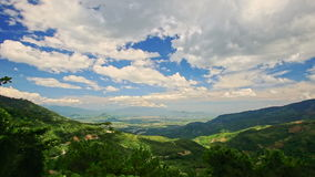 Green Valley among Hills Bright Blue Sky with White Clouds. Panorama of beautiful green forestry valley among hills against bright blue sky with white clouds stock video