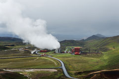 Green valley with industrial view of geothermal power station, K Stock Photo