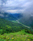 Green valley with a meandering road and river. Royalty Free Stock Photo