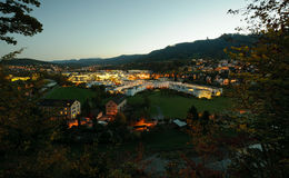 Green valley with offices and houses. Residential and service buildings in a green valley in Switzerland at dusk Royalty Free Stock Photos
