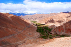 Green valley and red mountains Stock Image