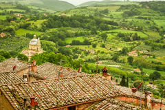 Green valley and red roofs in Volterra Stock Images