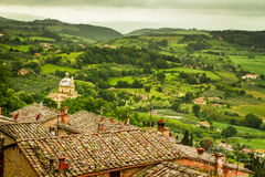 Green valley and red roofs in Volterra Royalty Free Stock Photos