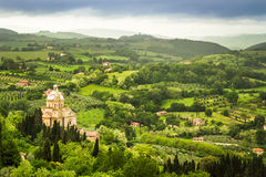 Green valley and red roofs in Volterra Stock Photo