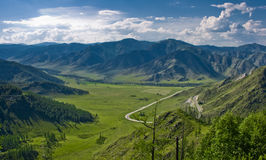 Green valley with road in Altai mountains Stock Image