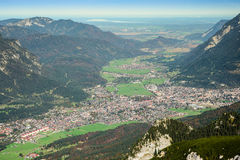 Green valley with small town in Alps mountains Stock Photo