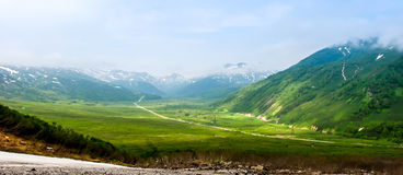 Green valley. Surrounded by mountains, located at Kamchatka, Russia, during the sunrise stock images