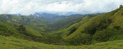 Green Valley to the Sea. A valley between verdant hills leads toward the Golfo de Nicoya in Guanacaste, Costa Rica on a foggy, rainy day (panorama Royalty Free Stock Images