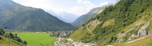 Green valley with white mounts. Green valley with white mount - Balme pass - France - The Alps - Panorama Stock Photo