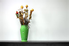 Green vase. Full of dried roses and lavender Stock Photos