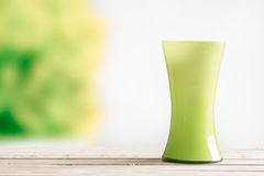 Green vase on a wooden table. In the garden royalty free stock photos