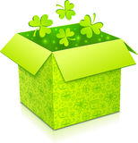 Green vector gift box with clovers inside Stock Photography