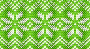 Green vector realistic knit seamless pattern with white snowflakes and zig zag ornament Royalty Free Stock Photography