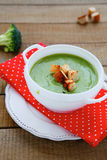 Green vegetable cream soup with croutons Royalty Free Stock Image