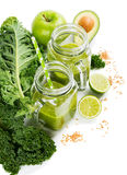 Green vegetable drink with fiber on a kale leaf. Royalty Free Stock Photos