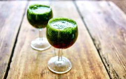 Free Green Vegetable Juice In Wine Glass Royalty Free Stock Images - 56400539