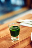 Green vegetable juice. On wooden table Stock Photography