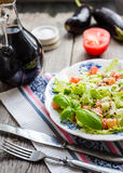 Green vegetable salad with tomato, eggplant, sesame seeds and ba Stock Image