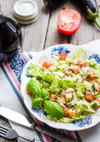 Green vegetable salad with tomato, eggplant, sesame seeds and ba Stock Photography