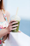 Green vegetable smoothie - healthy eating concept. Royalty Free Stock Photo
