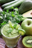 Green vegetable smoothie and ingredients. Royalty Free Stock Photography