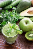 Green vegetable smoothie and ingredients. Stock Photos