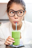 Green vegetable smoothie juice - woman drinking Stock Photos