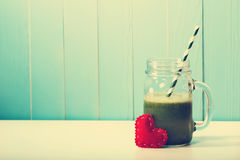 Green vegetable smoothie made with love Royalty Free Stock Image