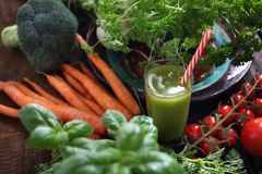 Green vegetable smoothie. Organic vegetables straight from the garden and a glass of drink royalty free stock image