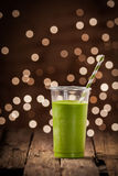 Green vegetable smoothie with party lights Royalty Free Stock Image