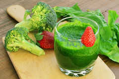 Green vegetable smoothie with strawberries Stock Photo