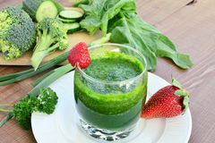 Green vegetable smoothie with strawberries Royalty Free Stock Image