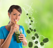 Green vegetable smoothie. Woman living healthy lifestyle drinking vegetable smoothies. Stock Photo