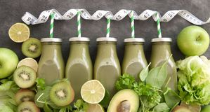 Green vegetable smoothies in a row royalty free stock image
